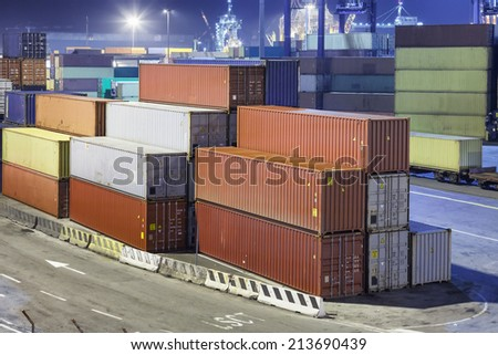 container operation in harbor by night - stock photo