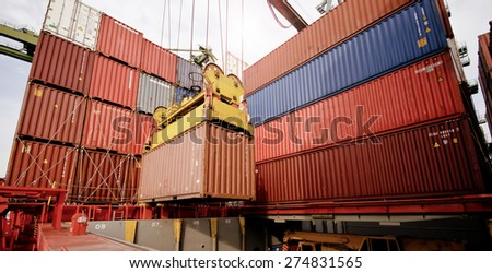container operation in port with cranes and gantry loading / discharging containers - stock photo