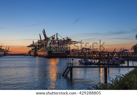Container Port in the light of the setting Sun, Hamburg, Northern Germany