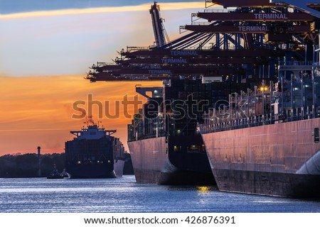 Container Port of Hamburg in the light of the setting sun; Northern Germany - stock photo