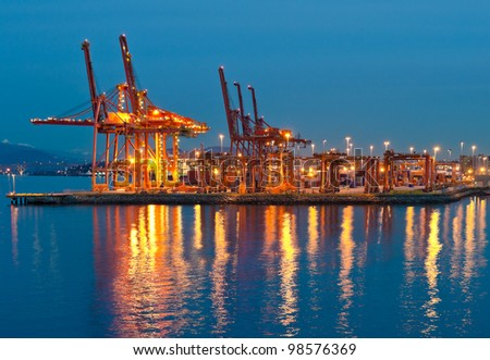 Container port terminal at disk (dawn, night ) in Vancouver,  BC - stock photo