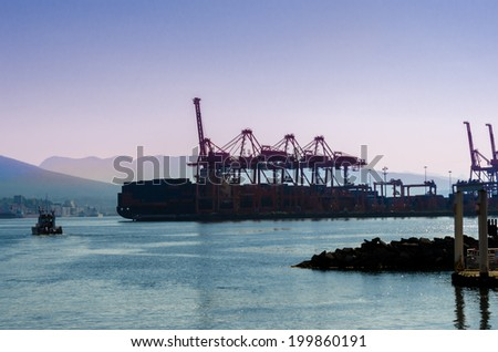 Container  port Terminal at sunset, sunrise time. Vancouver, Canada. - stock photo