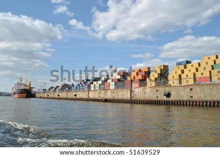 Container ship and containers in Hamburg harbor - stock photo