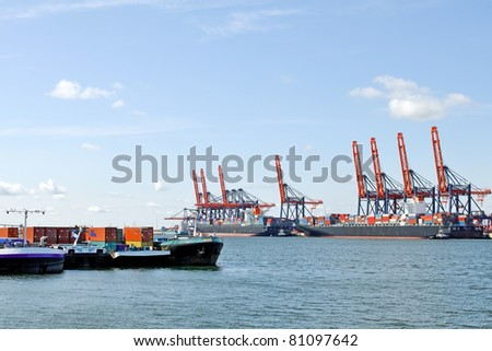 container ship and harbor cranes - stock photo