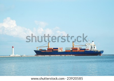 Container ship and lighthouse