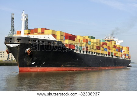 container ship approaching the harbor - stock photo