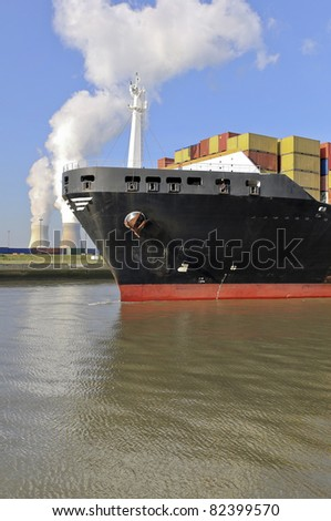 container ship approaching the harbor of antwerp - stock photo