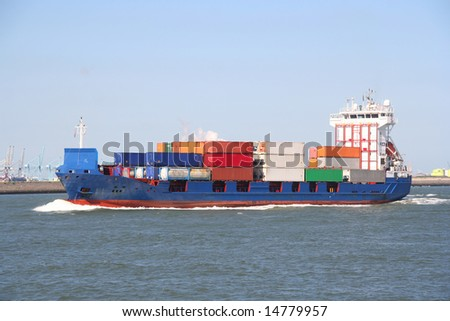Container ship arriving at the harbor - stock photo