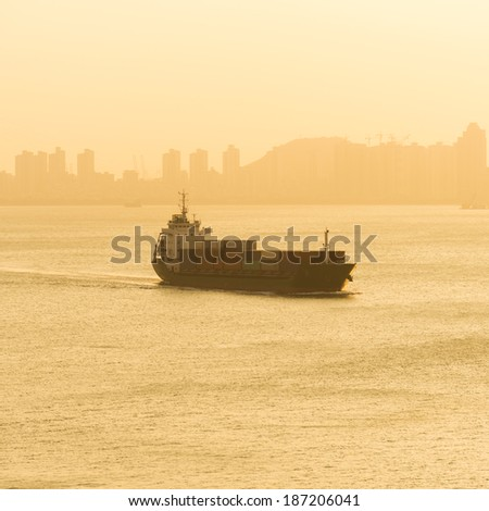 container ship arriving in port. - stock photo