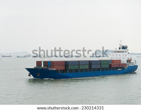 container ship arriving in port.