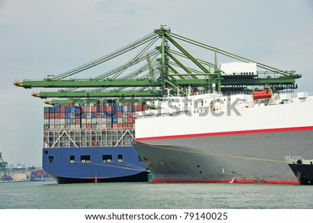 Container Ship At A Busy Port - stock photo