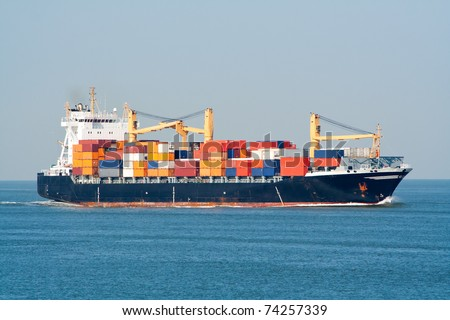 Container ship at sea - stock photo