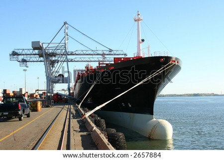 Container ship being loaded - stock photo