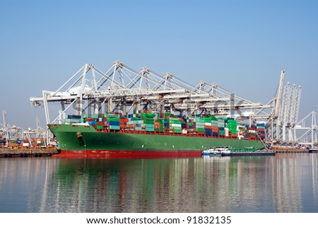 Container ship being loaded in the port of Rotterdam, The Netherlands - stock photo