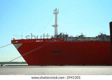 Container ship being unloaded 2 - stock photo