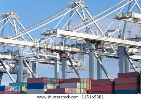container ship being unloaded in Rotterdam harbor - stock photo