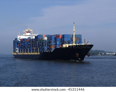 Container ship coming into port. - stock photo