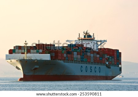 Container ship COSCO Phillipines on the high seas.  East (Japan) Sea. Pacific Ocean. 01.08.2014