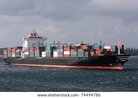 Container ship cruising into port.