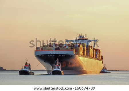container-ship entering or leaving the port - stock photo