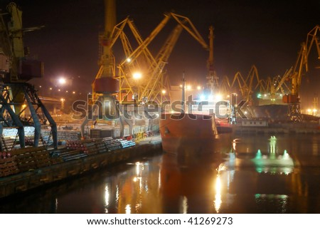 Container ship in a sea night industrial freight port