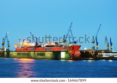 Container ship in dry dock, Hamburg - stock photo