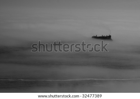 stock-photo-container-ship-in-fog-32477389.jpg