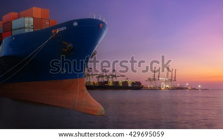 container ship in import export port of loading ship yard use for freight and cargo shipping vessel transport at twilight time. - stock photo