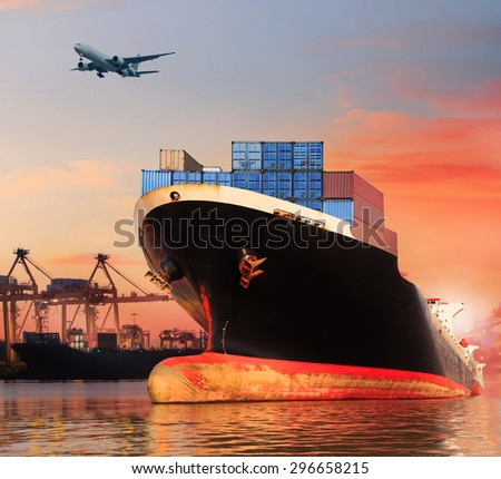 container ship in port and cargo plane flying above - stock photo