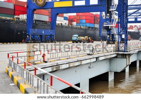 Container ship in port at container terminal. Ships of container ships stand in terminal of port on loading, unloading container