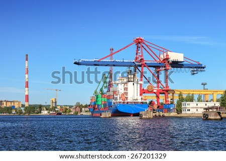 Container ship in port of Gdansk, Poland - stock photo