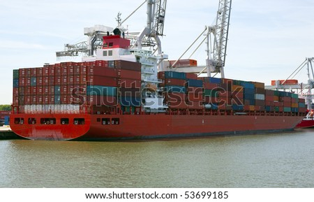 container ship in the harbour of rotterdam - stock photo