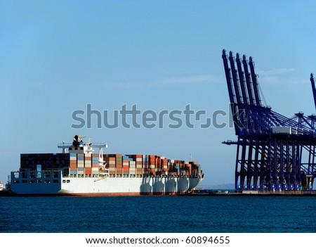 container ship in the port of algeciras - stock photo