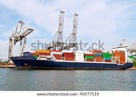 container ship in the port of rotterdam - stock photo