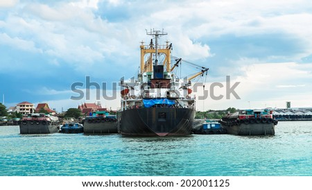 Container ship in the river for Logistic Import Export background - stock photo