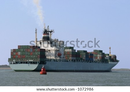 container ship leaving port of rotterdam-Holland - stock photo