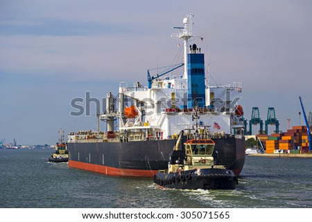 Container ship leaving the container terminal in Port of Antwerp, Belgium - stock photo