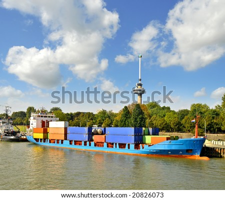 Container ship loading containers at the Port of Rotterdam,Holland - stock photo