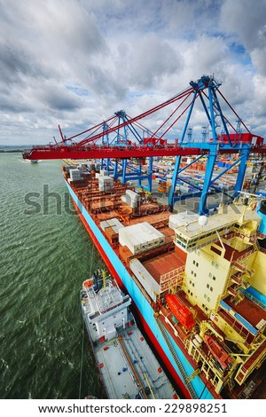 container-ship mored in a large container port, high-above perspective - stock photo
