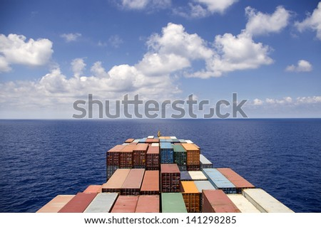 Container ship move on the ocean - stock photo