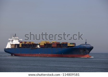 container ship nearby the harbour of rotterdam - stock photo