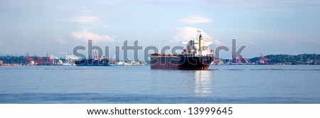Container ship on Puget Sound under Mt Rainier - stock photo