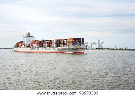Container ship on river Elbe, Germany