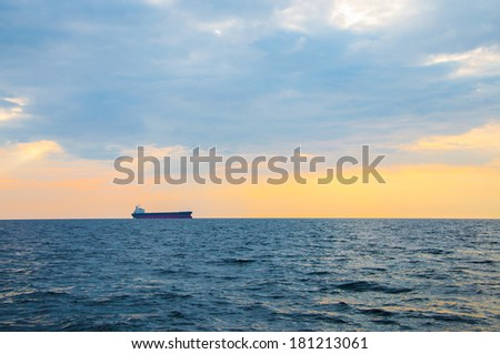 Container ship on the horizon - stock photo