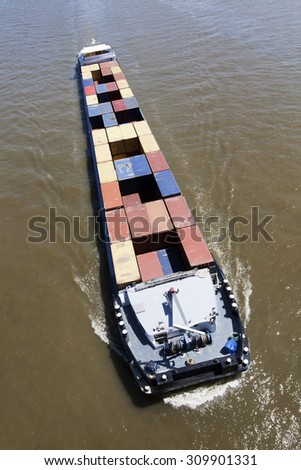 Container ship on the river  - stock photo