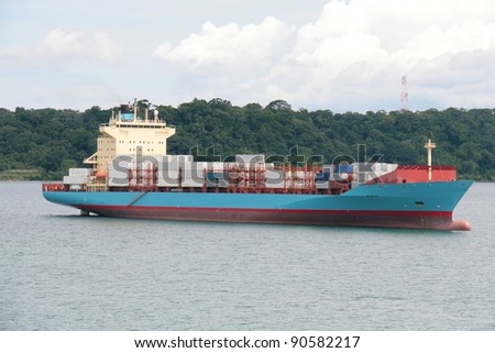 container ship passing through panama canal - stock photo