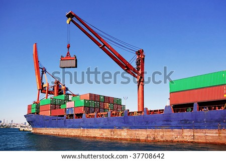 Container ship with crane - stock photo