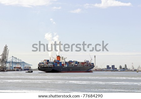 container ship with pilot boat - stock photo