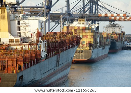 container ships in port in bahamas - stock photo