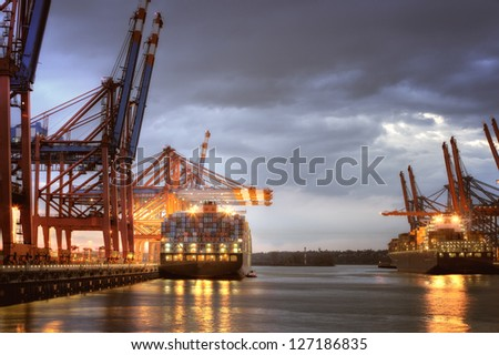 Container Ships in the harbor at Hamburg, Germany. Night shot.